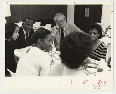 President Singletary; John Smith, the first Minority Vice President at the University of Kentucky; and unidentified Black House students are sitting around a table and talking