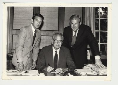 From the left:  Dicky Parsons, Central Development at the University of Kentucky; President Singletary; and Terry Mobley, Director of Central Development.  President Singletary is signing a paper as Dicky Parsons and Terry Mobley watch