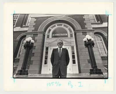 President Singletary is standing in front of the front door of the Administration / Main Building