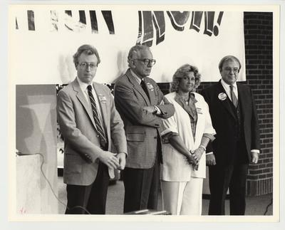 From the left:  unidentified man; President Otis Singletary; Barbara Ricke; and Mr. Dudley Webb, Alumnus of the University of Kentucky Law School.  They are at a Press Conference for Higher Education Rally.  The picture is from the University of Kentucky Publication Bureau