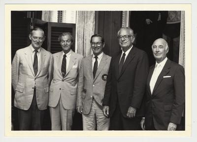 President Singletary is standing with four men.  From the left:  Ted Bassett, unidentified person, unidentified person, President Singletary, and Albert Clay