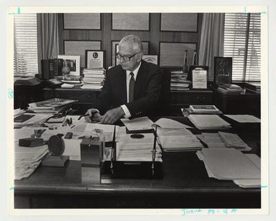 President Singletary is working at his desk