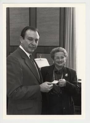 Harriett Rose, former faculty in Psychology Department and president of UK Association of Emeriti Faculty, gives a one thousand dollar check from the UK Association of Emeriti Faculty to President Charles Wethington for the Commonwealth library / William T. Young Library