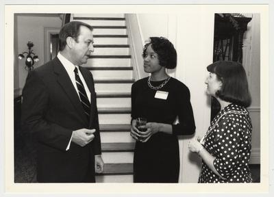 President Wethington (left) with an unidentified African-American woman, and Susan West (far right) from the Student Affairs Office
