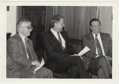 President Wethington is sitting and talking with two men.  From the left:  Paul Willis, Director of Libraries; Adkins, Vice President of Humana Corporation in Louisville, Kentucky; and President Wethington