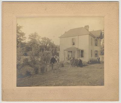 James White is in his garden.  The picture shows the back of the White home on the corner of Maxwell Street and Harrison Avenue in Lexington, KY