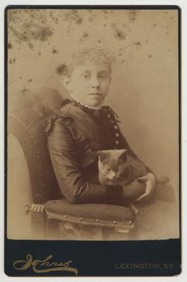 An unidentified female member of James White's family holding a cat