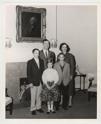 A Dickey family photograph taken in front of a fireplace.  Front row from the left:  Frank Dickey Jr., Ann, and Joe.  Back row from the left:  President Dickey and his wife Betty.  Received by Public Relations on August 17, 1957