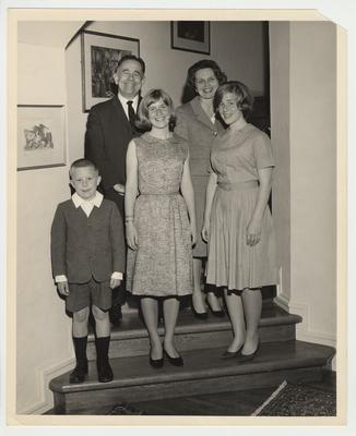 President Oswald, Rosanel, and their children standing on a stairway.  The children from the left are Johnny, Elizabeth, and Nancy
