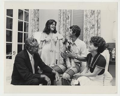 President Singletary and his family in Maxwell Place.  From the left:  President Singletary, Kendall, Scott holding Butch the family dog, and Gloria