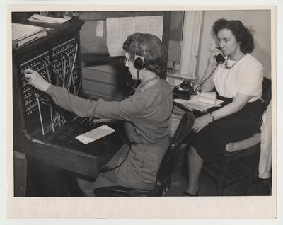 Two unidentified women are operating a switchboard