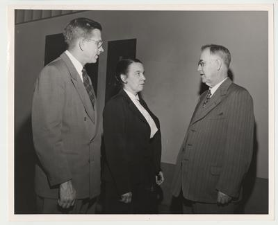 Bruce Denbo (left), director of the University Press of Kentucky, and President Donovan (right) are talking to the Marie Campbell (center), the recipient of the Kentucky Fellowship Award winner