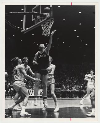 The University of Kentucky College of Dentistry Basketball team versus the University of Kentucky Freshman basketball team.  Cliff Berger.    From the left:  Jimmy Dan Conner (#20), Bob Guyette, unidentified UKCD player, G.J. Smith, and Keven Grevey (#35)