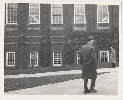 Three unidentified men walking past Margaret I. King Library