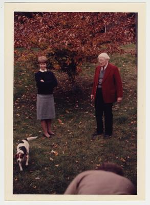 A color photograph of Martha Birchfield (wife of Library's Collection Development Head, James Birchfield) and W. Hugh Peal watch the loading of the Peal Collection