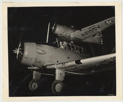 An unidentified man is sitting in an Army plane