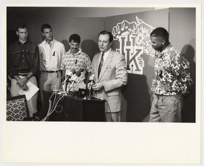 John Pelphrey (far left), Deron Feldhaus (second from left), Richie Farmer (third from left) and Sean Woods (right) are listening to UK President Charles Wethington (second from right) talk to the press