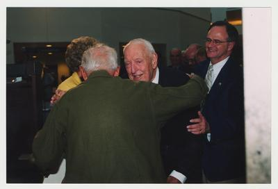 Thomas Clark (center) is greeting an unidentified man while President Lee Todd (right) watches at Dr. Thomas D. Clark's 100th birthday celebration at Young Library