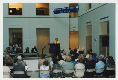 Patricia B. Todd is giving opening remarks at Dr. Thomas D. Clark's 100th birthday celebration at Young Library