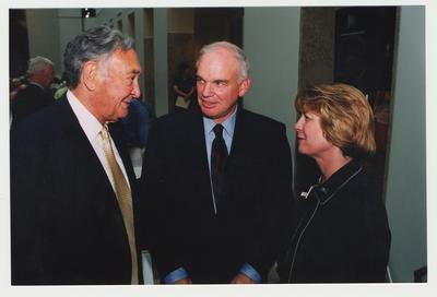 Carol Diedrichs (right), Dean of Libraries, is talking with Mike Nietzel (center), Provost, and former Governor of Kentucky Louie Nunn (left) at Dr. Thomas D. Clark's 100th birthday celebration at Young Library