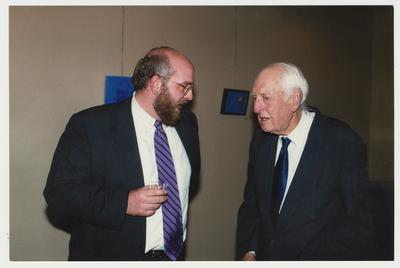 Dr. Thomas D. Clark (right) is talking with Stephen Wrinn (left), the new Director of the University Press of Kentucky during a welcome reception for Stephen Wrinn
