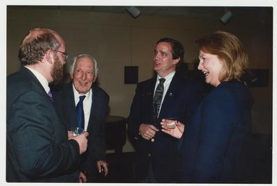 Stephen Wrinn (left), Director of the University Press of Kentucky, is talking with Dr. Thomas Clark (second from the left), an unidentified man (second from the right) and Margaret Lane (right) at the Welcoming Reception for the third Director of the University Press of Kentucky, Stephen Wrinn.  Margaret Lane co-authored
