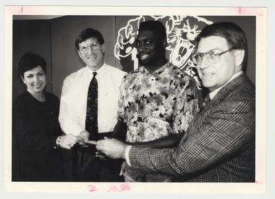 From the left:  Paula Pope, Coach Curry, Derrick Thomas, and Bob Slone