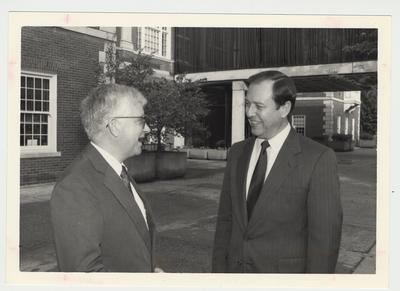 President Charles Wethington (right) is talking with Paul Willis (left), Director of Libraries, near M. I. King Library