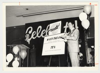 President Charles Wethington (right) and two unidentified men are at the Library Campaign Kick Off Luncheon