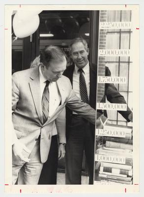 President Charles Wethington (left) and Athletic Director C. M. Newton (right) during the Library Campaign