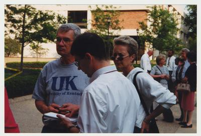 Frank Burch (on Left) and Sue Burch are standing near the Administration / Main Building during the fire