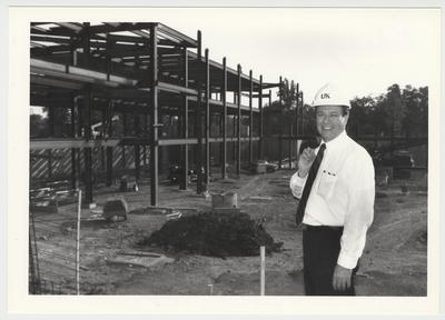 President Charles Wethington is at the site of the construction of the William T. Young Library