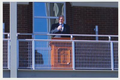 Terry Mobley (head of Development) is speaking from the balcony of the renovated Main Building after the fire, at the reopening of the Main Building