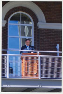 President Lee Todd is speaking from the balcony of the renovated Main Building after the fire, at the reopening of the Main Building