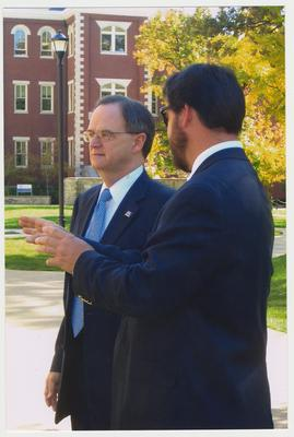 President Lee Todd (left) is talking with  David Doss (right), with Messer Construction Company, before the reopening of the Main Building