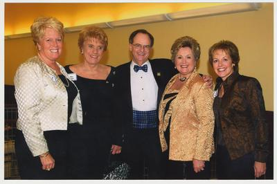 From the left:  Mariam Sims, Alice Sparks, President Lee Todd, Patsy Todd, and Marianne Smith Edge.  They are at a ceremony for the reopening of the Main Building