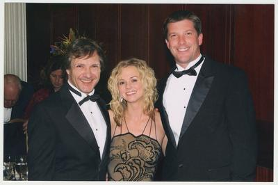 Kathryn Todd (center), the daughter of President Lee Todd and Patsy Todd, is with two unidentified men.  The man on the right is her escort