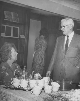 In the Rare Book Room in Spindletop, for the dedication of the King Library Annex, Hugh Peal and Helen King, with Margaret Lisle in the rear