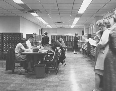 Students studying in King Library Annex, Reference Room on the first floor. Received September 13, 1966 from Public Relations