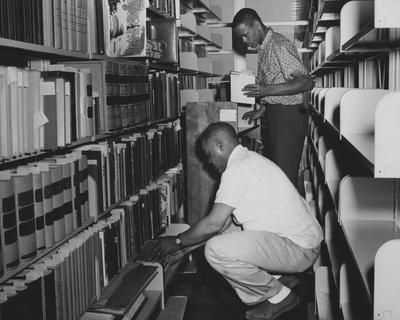 Two male students are moving items into or out of the Annex of the King Library. Received June 4, 1962 from Public Relations