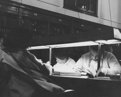 Students studying at night in the Breckinridge Room of King Library