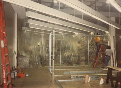 A color photo of the renovation of room 110, the Special Collections Department. Unidentified men are building new offices. Photographer: Terry Warth
