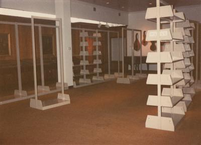 A color photo of shelving being put up in the Peal Gallery in the Margaret I. King North Library. Mr. Peal is one of the first to give books to the University of Kentucky. Photographer: Terry Warth
