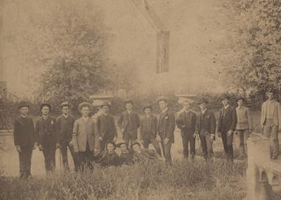 Group of male students in 1886 or 1887; photo probably taken in the yard of Maxwell Place. Some of the names listed are: (fourth) Jesse Mills, (sixth) Keene R. Forston, (ninth) James Guthrie Herr, (thirteenth) J. Tandy Ellis