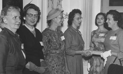 Inside Maxwell Place; September 23, 1958, University of Kentucky's Women's Club. From right: unknown, Bonnie Bradley, Mrs. Frank G. Dickey, E. Diashun, and two unknowns. This is a Herald Leader Photograph. Received October 8, 1958 from Public Relations