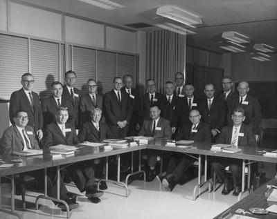 Members of the Medical Center seated around a table