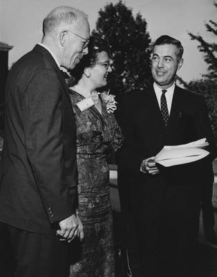 President Frank G. Dickey (far right) is conversing with two unidentified people