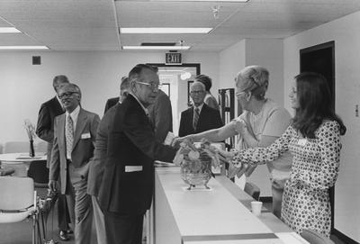 Wendell Ford shaking hands with unidentified people at the dedication of the Medical Center