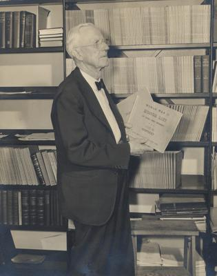Ezra Gillis with the World War II Honor List of Dead and Missing, 1949. The list was placed in Memorial Coliseum. Photographer: Mack Hughes