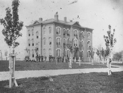 Unidentified building with young men